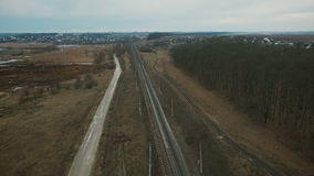 Aerial view: fields, roads, track, trees in the village in Ukraine stock video footage