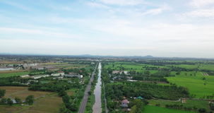 Aerial view of Fields with various types of agriculture and Irrigation canal in rural Thailand stock footage