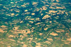 Aerial view of the fields and villages. Aerial view from the plane to the fields and villages Royalty Free Stock Image