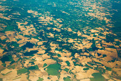 Aerial view of the fields and villages. Aerial view from the plane to the fields and villages Stock Images