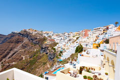 Aerial view of Fira town on the edge of the caldera cliff on the island of Thira (Santorini), Greece. Aerial view of Fira town on the edge of the caldera cliff Stock Photos
