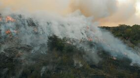 Aerial view at fire at garbage dump, burning pollutes the environment. Ecological catastrophe and destruction of nature