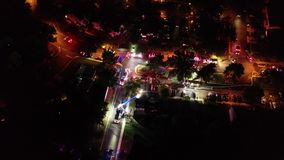 Aerial View of Fire Trucks and Apparatus on Scene of House Fire.  stock footage