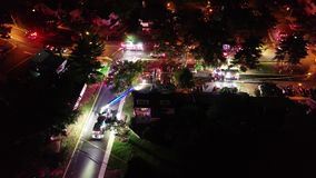 Aerial View of Fire Trucks and Apparatus on Scene of House Fire.  stock video footage