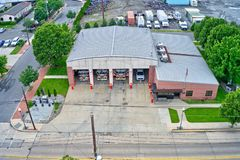 Aerial View of a Firehouse with Fire Engines Inside.  royalty free stock photos
