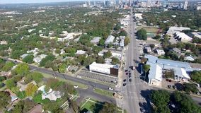 Aerial view of firetruck passing cars at an intersection stock video footage