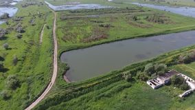 Aerial view of fish farm, cage fish farming, lake with fry. Natural pool stock video footage