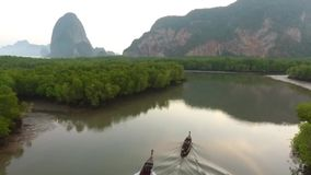 Aerial View: Fisherman Boat Sailing in Mangrove Forest in Phang Nga Province At Beautiful Sunrise. HD Slowmotion. stock video