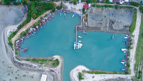 Aerial view of fisherman village marina on the tropical island. Fisherman village marina in Koh Phangan, Thailand Royalty Free Stock Photo