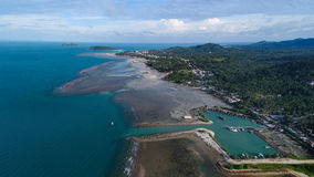 Aerial view of fisherman village marina on the tropical island. Fisherman village marina in Koh Phangan Thailand Royalty Free Stock Photo