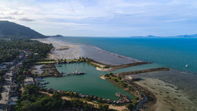 Aerial view of fisherman village marina on the tropical island. Fisherman village marina in Koh Phangan, Thailand Royalty Free Stock Photography