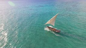 Aerial view of fishermen go out on sailboats to the ocean for fishing. Zanzibar.
