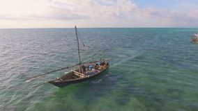 Aerial view of fishermen go out on sailboats to the ocean for fishing. Zanzibar. stock footage