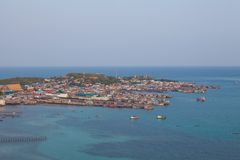 Aerial view of fishermen town on sunset Royalty Free Stock Photos