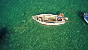 Aerial view of a fishing boat in Mali Ston Bay stock video footage