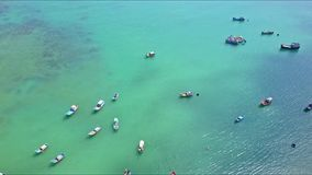 Aerial View Fishing Boats Float on Sea Surface by Coast stock footage
