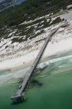 An aerial view of a fishing pier in Panama City beach, Florida in the waters of the emerald green Gulf of Mexico. Near St. Andrews Bay and Shell Island Stock Image