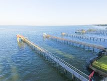 Kemah fishing piers aerial. Aerial view of fishing piers stretching out over the Galveston Bay in Kemah city, Texas, USA. Bird eye view of Kemah Lighthouse Stock Images