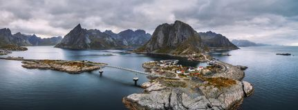 Aerial view of fishing villages in Norway. Aerial panorama of Reine and Hamnoy fishing villages with fjords and mountains in the background. These villages are Royalty Free Stock Image