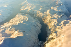 Aerial View - Fjords of Norway. An aerial view of the snow covered mountains of the fjords of Norway in the winter Royalty Free Stock Images