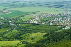 Aerial view flat land. Aerial view of flat land with forests, agricultural fields, farms and villages in the Altai region (Russia Stock Image