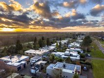 Aerial view Flat roof bungalow houses. In residential area on dutch countryside in Groningen Province, Netherlands royalty free stock images
