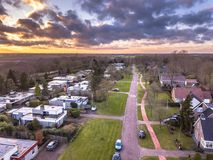 Aerial view bungalows and houses. Aerial view of Flat roof bungalow and houses in residential area of town on dutch countryside in Groningen Province royalty free stock photography