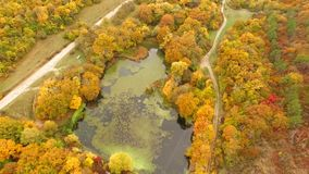 AERIAL VIEW. Flight Above Scenic Terrain At Fall Time stock video footage