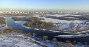 Aerial View. Flight over the beautiful winter river and forest. Nature in winter. Landscape panorama. Ukraine stock video