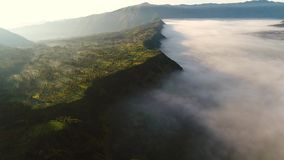 Aerial view flight over Cemoro Lawang stock footage