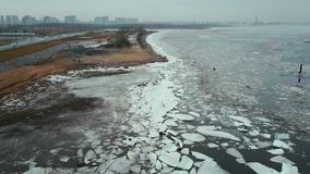 Aerial View Flight over the melting ice of the Northern Gulf The Frozen Finnish Gulf and shore in Melting Ice. Outstanding Scenery stock video