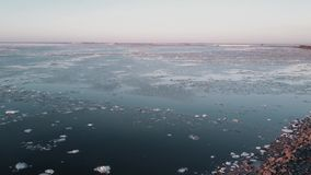 Aerial View Flight over the melting ice of the Northern Gulf The Frozen Finnish Gulf and shore in Melting Ice. Outstanding Scenery stock footage