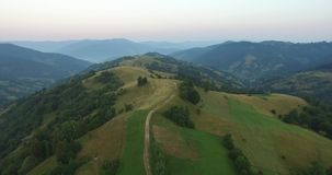 Aerial View Flight over the Mountains. Ukraine. Sunevyr. Flying over the Trees. Forest Valley. Morning Fog stock footage