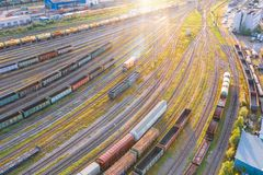Free Aerial View Flight Over Rail Sorting Freight Station With Various Wagons, With Many Rail Tracks Railroad. Heavy Industry Landscape Stock Photo - 156406380