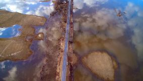 Aerial view flight of water tide and road stock video