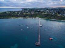 Aerial view of Flinders coastline and pier with moored boats. Me. Aerial view of Flinders coastline and pier with moored fishing boats a, Mornington Peninsula Stock Photos