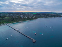 Aerial view of Flinders coastline and pier with moored boats. Me. Aerial view of Flinders coastline and pier with moored fishing boats a, Mornington Peninsula stock photography