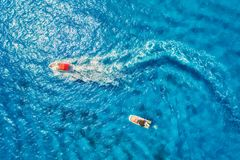 Aerial view of floating motorboat in transparent blue sea Stock Image
