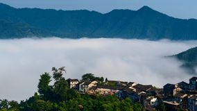 Aerial view of floating sea of clouds like cloud waves in mountains in early morning