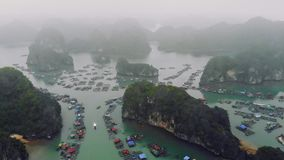 Aerial view of floating villages around Cat Ba islands. Cat Ba is the largest of the 366 islands, which make up the stock video footage