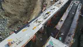 Aerial view of flood damage inspection on unfinished E-763 highway bridge construction. Serbia. Aerial view of flood damage inspection on unfinished highway stock video footage