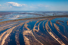 Aerial view of flood-land beside great river during spring Stock Image