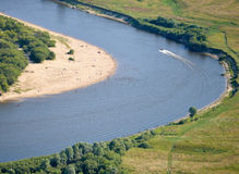 Aerial view on the flood land the great river during summer. Stock Photos