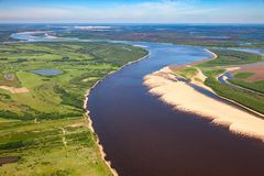 Big plain river, top view. Aerial view of floodland of great river during summer royalty free stock photos
