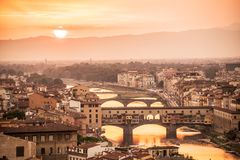 Aerial view of Florence at sunset  with the Ponte Vecchio and the Arno river, Tuscany Italy. Aerial view of Florence at sunset  with the Ponte Vecchio and the Stock Photo
