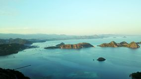 Aerial view of Flores Island archipelago. Exotic aerial view of Flores Island archipelago with turquoise sea water from a drone flying forward in Labuan Bajo stock video