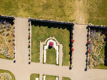 Aerial view of a flowering garden with flowerbeds and vases Royalty Free Stock Photo