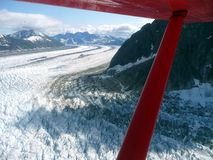 Aerial view of flowing glacier Stock Images