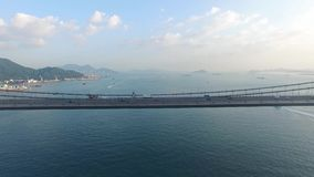 An aerial view fly over Tsing Ma Bridge under sunny day stock video footage