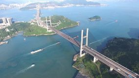 An aerial view fly over Tsing Ma Bridge under sunny day stock footage